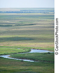landscape with small river on steppe
