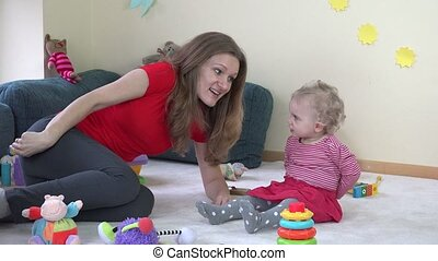 mother play with little baby daughter in room. Motherhood....