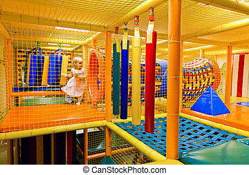 Maze Playground - Little girl playing inside of maze...