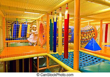Maze Playground - Little girl playing inside of maze...
