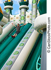 Boy in inflatable castle - Young boy playing in inflatable...