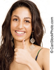 Smiling female thumbs up sign - Beautiful smiling girl...