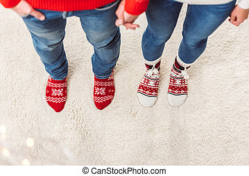 couple in knitted socks - cropped shot of young couple in...