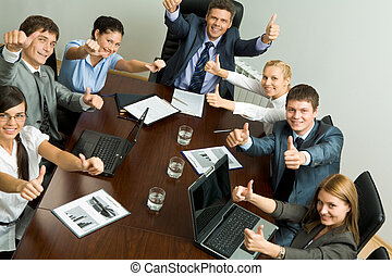 Success in business - Portrait of business people showing...