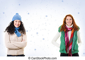 Girls in winterwear - Two friends in warm knitted clothes...