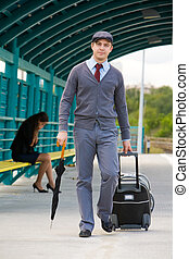 Walking man - Handsome man walking down railway station with...