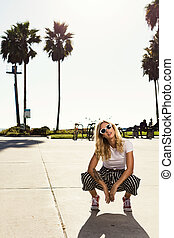 fashionista girl squatting on the broadwalk. - fashionista...