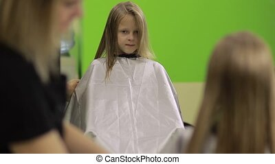 Professional hairdresser making stylish haircut - Adorable...