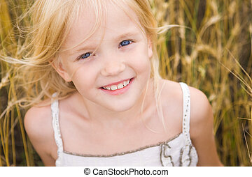Cute girl - Image of youthful girl lying in wheat and...