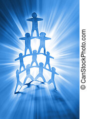 Human pyramid - Human team pyramid on bright blue background...