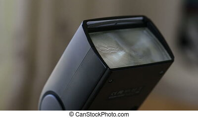 Flashing the built-in flash on the DSLR camera. Close-up -...