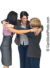 Team collaboration - Three business women standing in a...