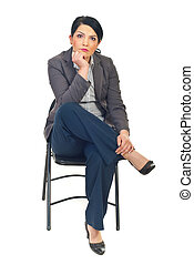 Misunderstood - Business woman sitting on chair and looking...
