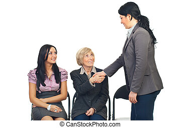 Business woman make acquaintance with a senior woman at...