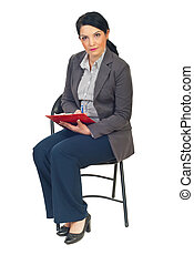 Business woman on chair taking notes - Serious business...