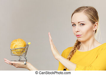 Woman holding shopping cart with bread - Buying gluten food...