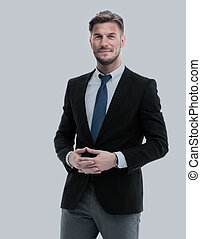 Successful young man in full suit smiling. - Portrait of a...