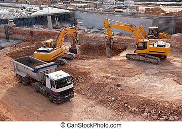 Construction Site - Construction site with tractors and dump...