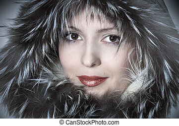Fashion woman in fur smiling Fashionable portrait of happy...