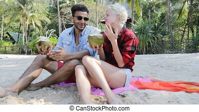 Couple On Beach Drink Coconut Cocktail Talking Sit Under...