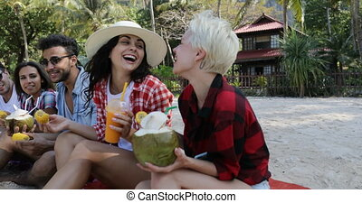 People Eat Tropical Fruits And Drink Coconut Cocktails...