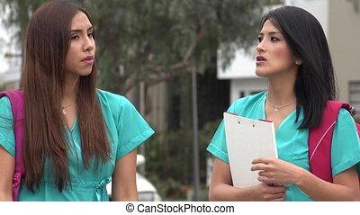 Female Student Nurses Talking