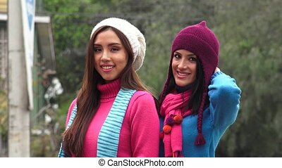 Cold Young Women Wearing Knit Sweaters