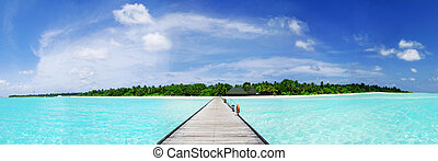 Maldives - Tropical Maldivian paradise - a jetty leading to...