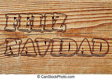 feliz navidad written in an old wooden board