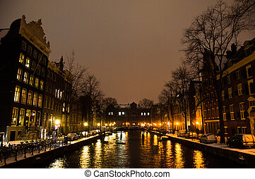 Snowy Amsterdam At Night - Amsterdam canals and typical...