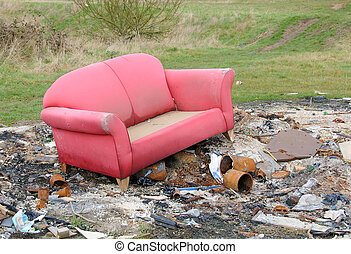 Example of 'fly tipping' in the UK - Abandoned sofa - xample...