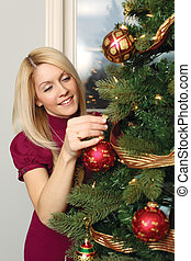 Hanging ornaments on a Christmas tree - Photo of a beautiful...