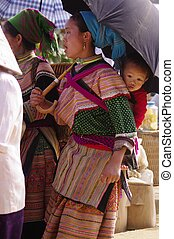 Woman Hmong flowered in market