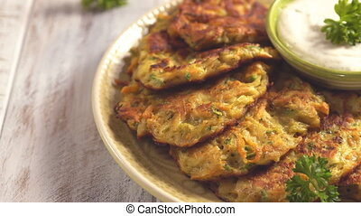 Vegetable fritters with potato, carrot and zucchini with...