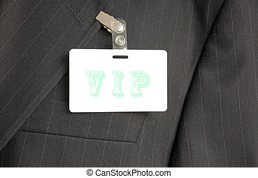 VIP badge - close up of black suit with VIP id card