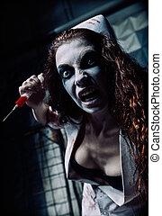 Horror shot: crazy evil nurse (doctor) with syringe in hand....