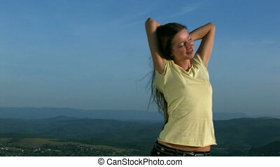 young woman on sunset