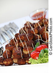 Buffet with meatballs as finger food-closeup