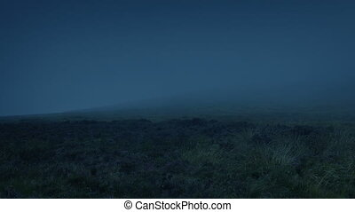 Mist Blowing Over Mountainside At Night - Rugged mountain...