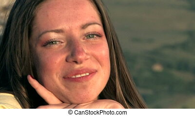 young woman smiling on sunset