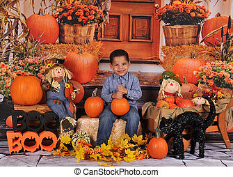 adorable african amercian boy posing at halloween with props