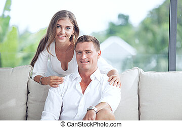 portrait of nice young couple in summer house environment
