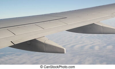 Jet wing detail. - Passenger jet in flight. Detail of wing.