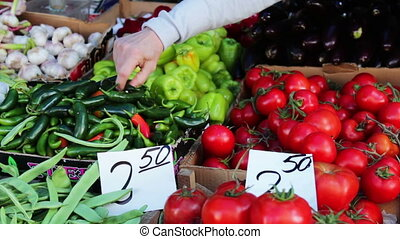 Delicious fresh cucumbers tomatoes and other vegetables with...