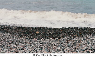 Sea waves beat on stony shore on the embankment of the...