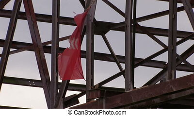 damaged red flag moving from wind