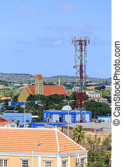 Cell Phone Tower on Bonaire - Colorful buildings on the...