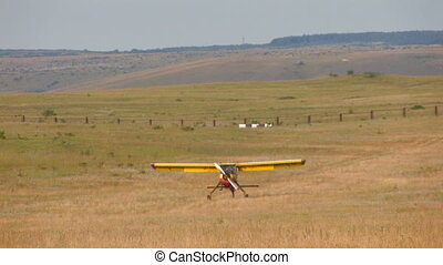 plane with propeller run in the middle of the field, Canon...