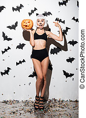 Pretty young woman in halloween costume cat - Picture of...
