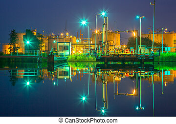 Docking site refinery - Docking site near water at a small...